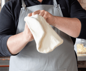1 super easy way to stretch pizza dough by hand
